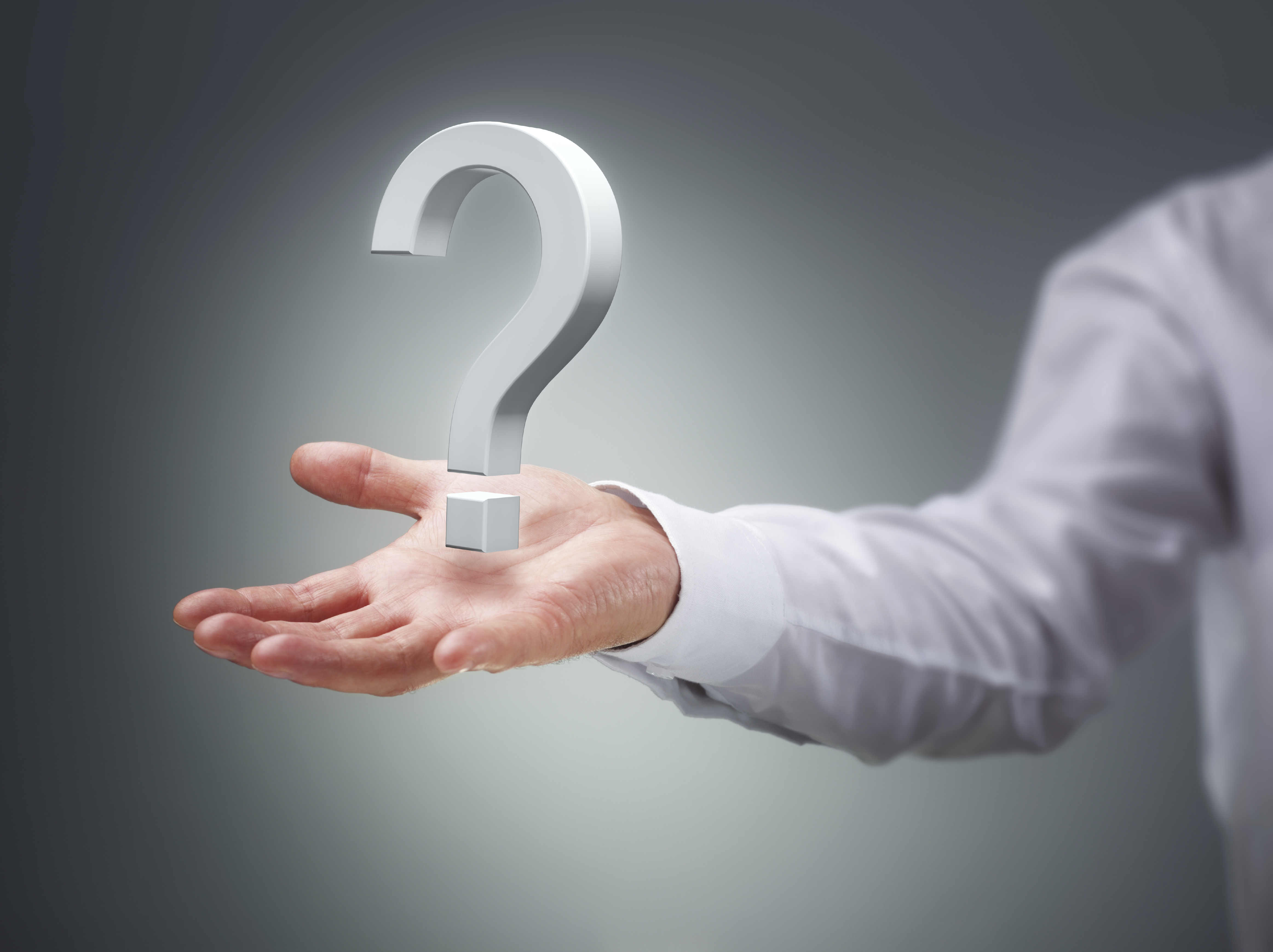 Businessman holding a virtual question mark concept for confusion, choice, searching or decisions